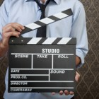 Businessman with clapperboard