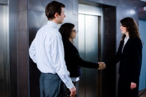 Business greeting at elevator