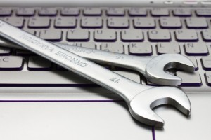 Spanner on keyboard representing fixing IT issues